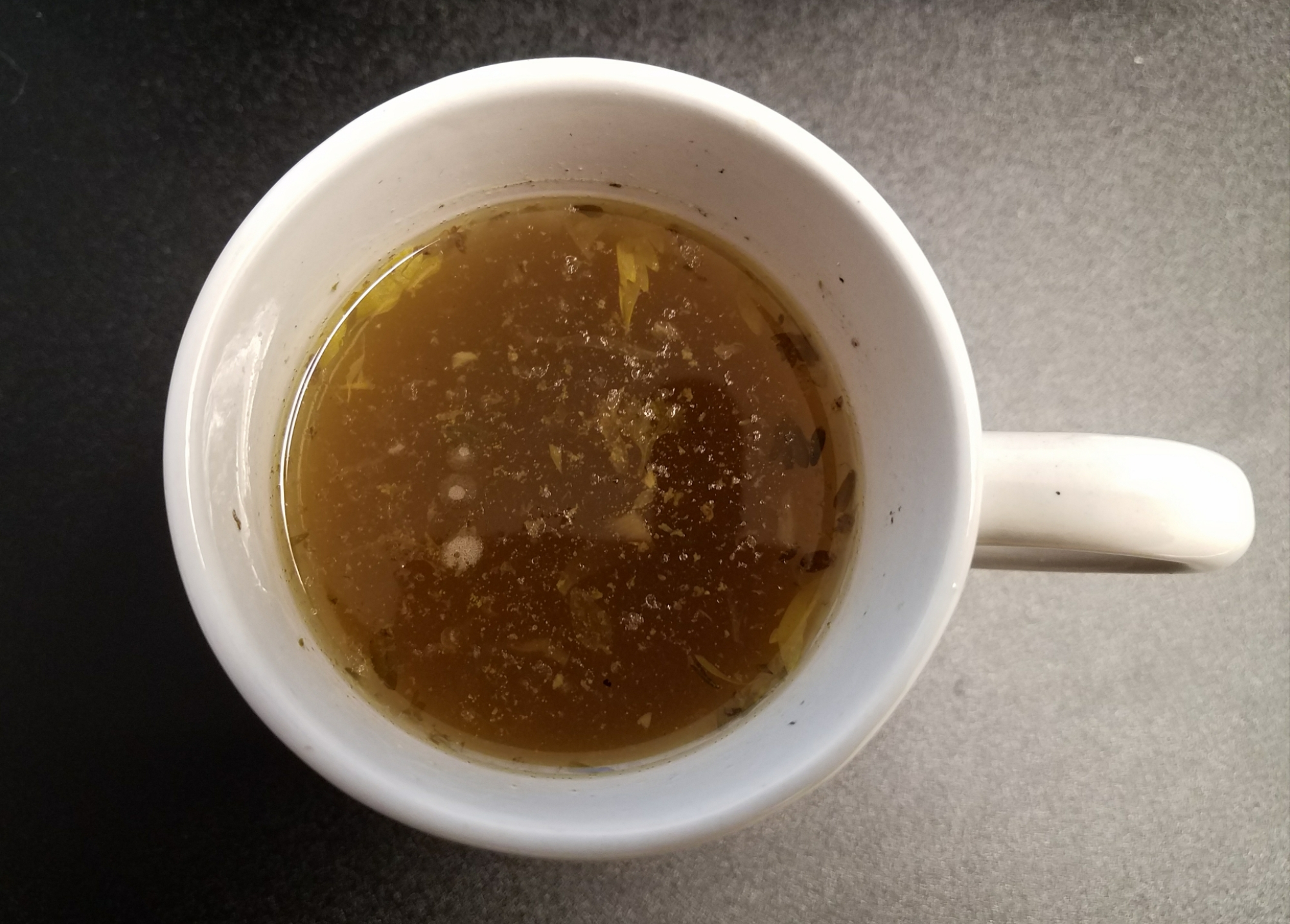 A cup of bone broth soup